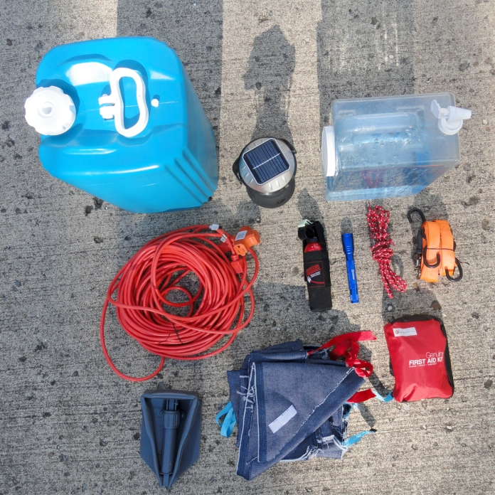 miscellaneous items stored in pockets of the car: 5 gallon water jug, solar charging lantern, 2.5 gallon water jug, extension cord, bear spray, flash light, rope, shovel (for burying things…), denim curtains for the car, first aid kit